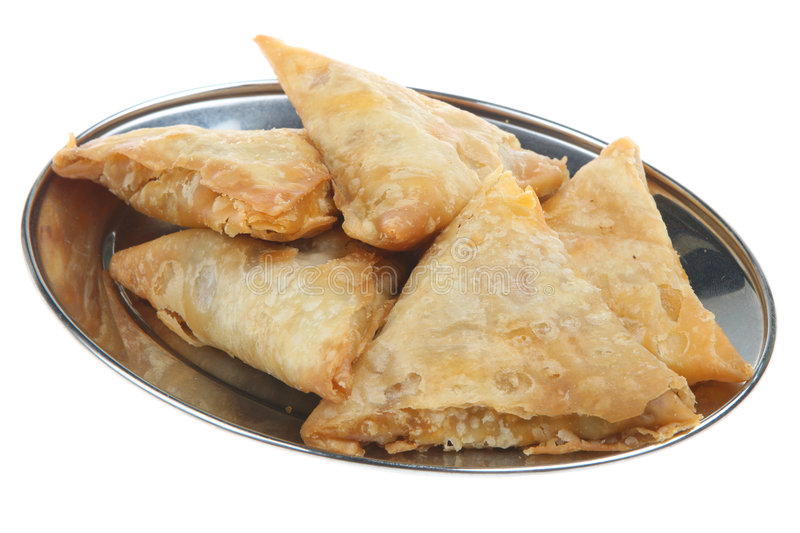 Platter of Indian Samosas. Filo pastry samosas filled with curried vegetable or meat mixtures royalty free stock photo