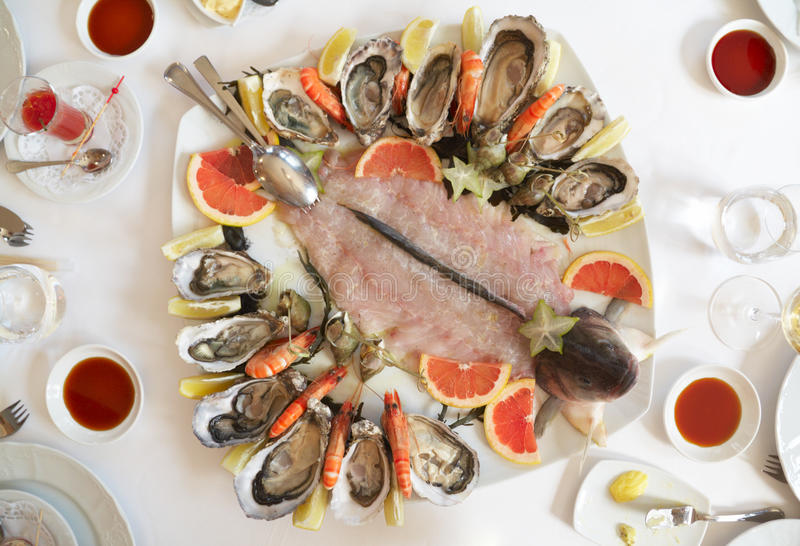 Platter with oysters and seabass carpaccio stock photos