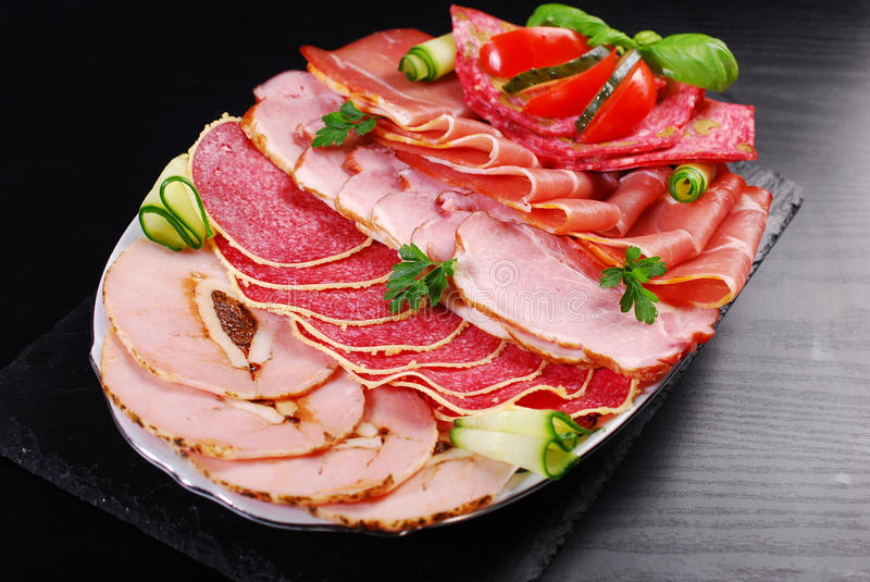 Platter of sliced ham,salami and cured meat stock photos