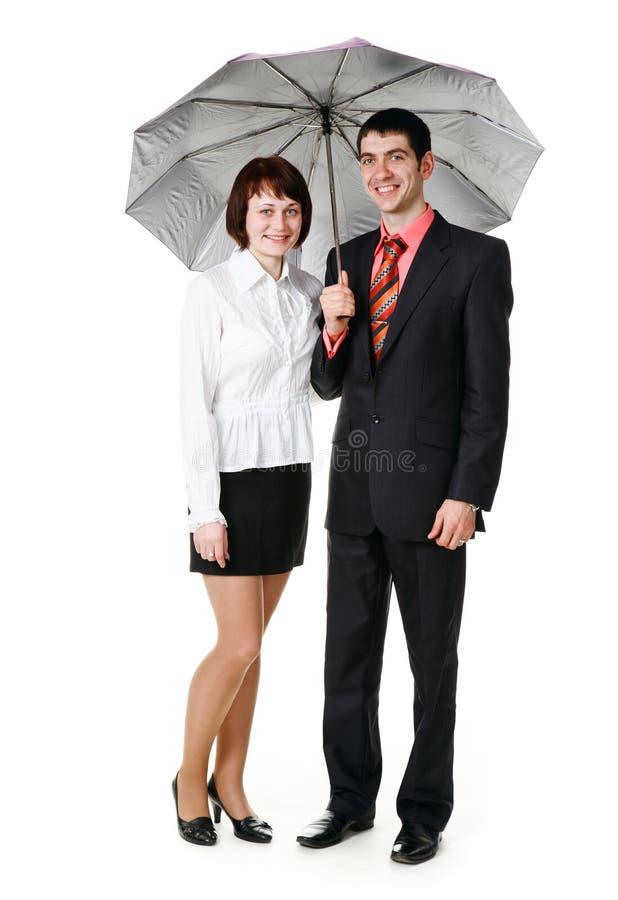 plattform paraply för man under kvinnabarn royaltyfri fotografi