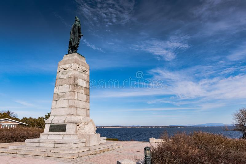Memorial to Samuel Champlain Facing Lake Champlain. Plattsburch, NY / USA / March 23, 2016: Monument to Samuel Champlain, the `Father of New France` who is stock image
