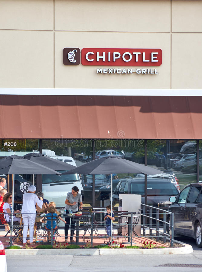 Chipotle restaurant and logo. PLATTSBURGH, USA - AUGUST 23, 2017 : Chipotle restaurant and logo. Chipotle Mexican Grill, Inc is an American chain of fast casual stock image