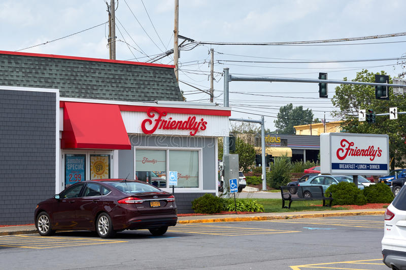 Friendly's restaurant and parking. PLATTSBURGH, USA - AUGUST 23, 2017 : Friendly's restaurant and parking. Friendly's is a restaurant chain on the United States royalty free stock photos