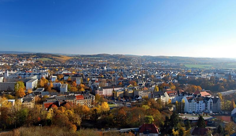 Plauen city panorama with nice landscape around in Germany during nice autumn day. Plauen city with nice landscape with small hills, meadows and colorful forest royalty free stock image