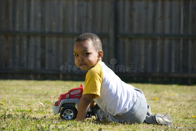Download At Play stock image. Image of preschool, yard, truck, biracial - 4552283