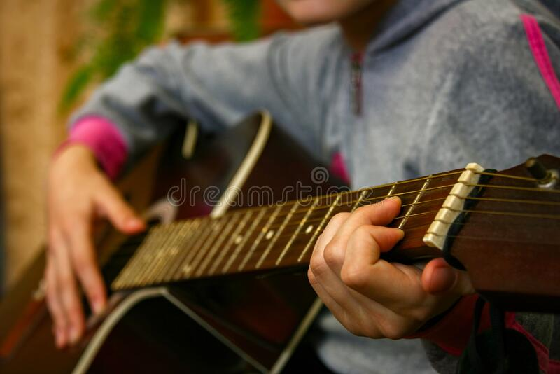 Play acoustic guitar royalty free stock photography
