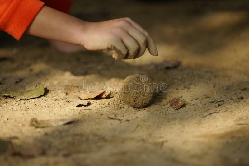 Play ball of mud. stock photo
