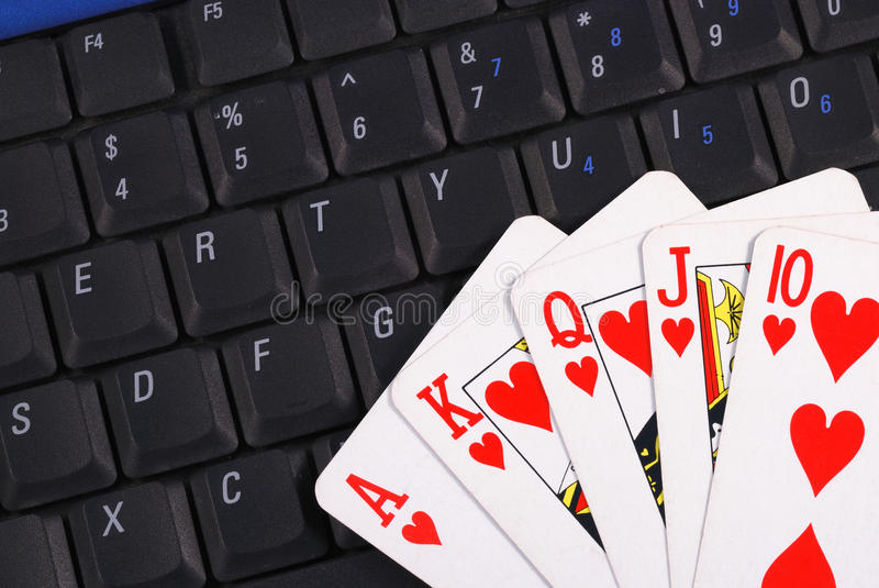 Play cards on a keyboard. Concepts of online gambling stock photos