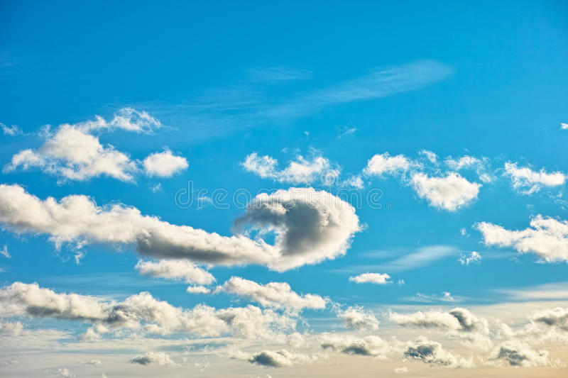 Play of clouds in blue sky royalty free stock photo