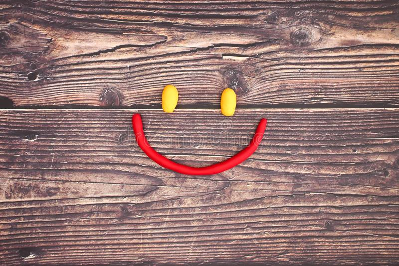 Play doh smiley with emotions stock photography