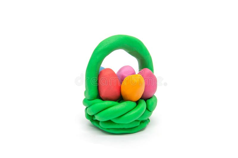 Play dough easter eggs in basket on white background royalty free stock photo