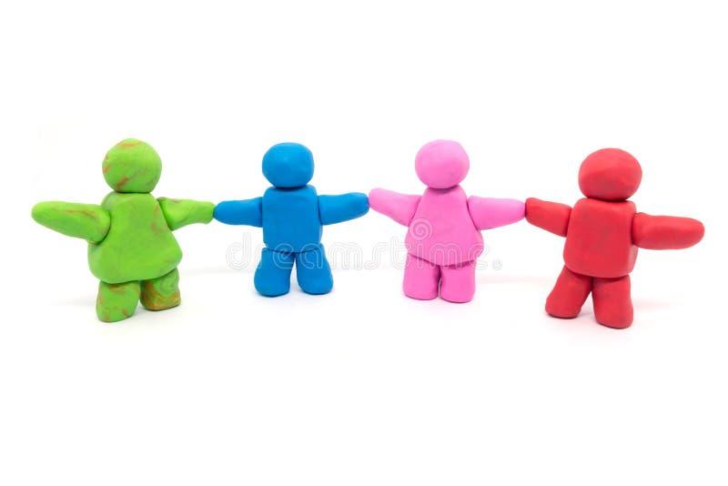 Play dough Human teamwork on white background.  stock photos