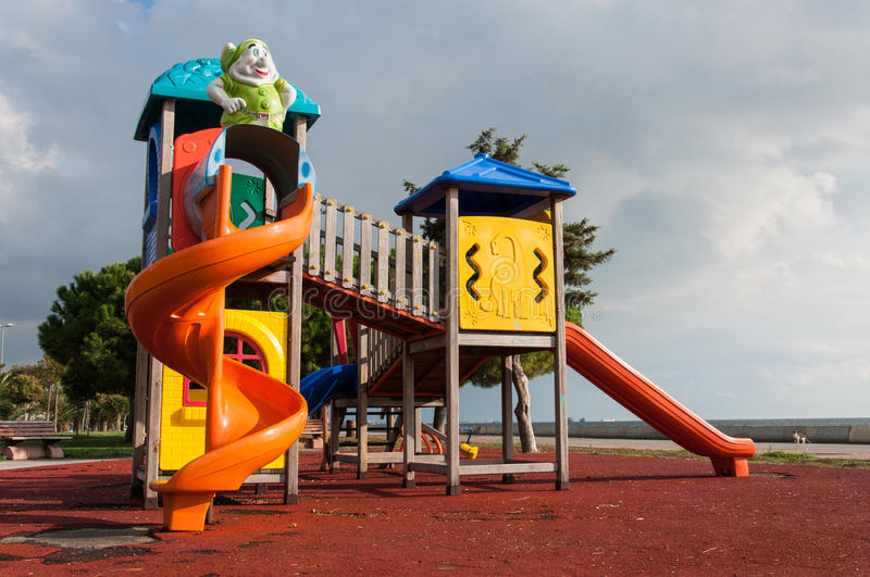 Play Ground. Colorful play ground outside in a sunny day with some green surroundings in the city royalty free stock images