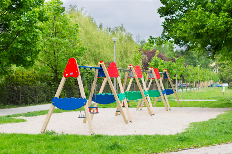 Play ground swings. Row of swings at a play ground royalty free stock photography