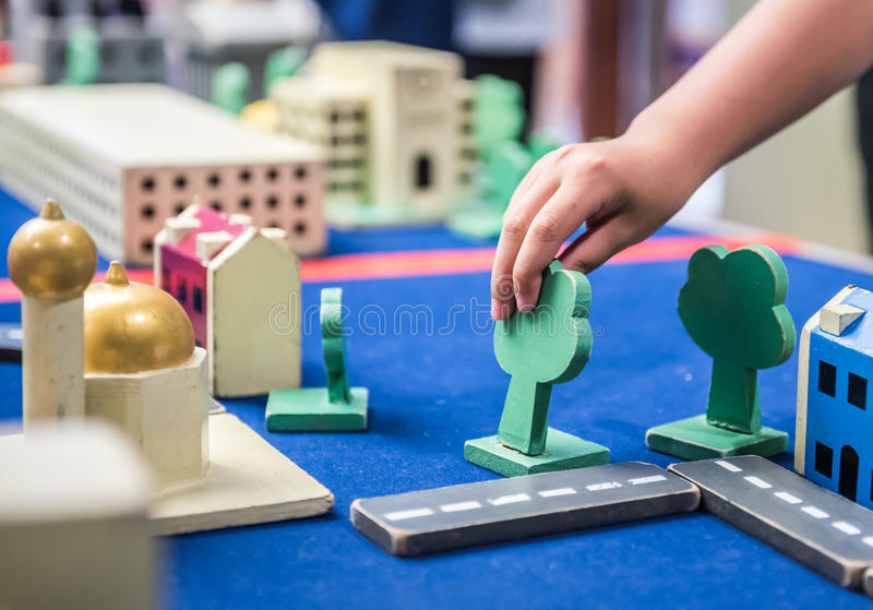 Play, learn and education. Playing game for Real Estate, kid learn and education royalty free stock image