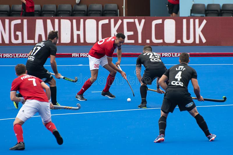 Great Britain v New Zealand - Men`s FIH Field Hockey Pro League. Play at the men`s FIH Pro Hockey League match between GB and New Zealand at Twickenham Stoop royalty free stock image