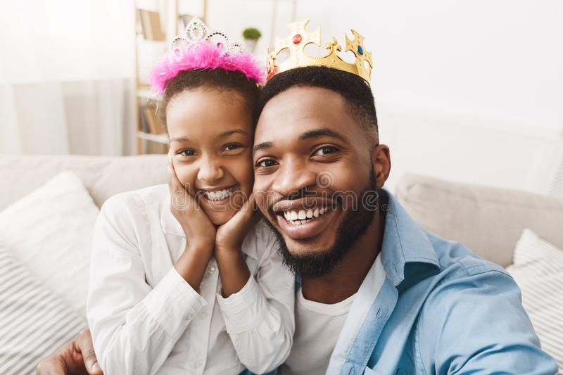 Play Princess. Father and Daughter In Crowns Taking Selfie royalty free stock photography