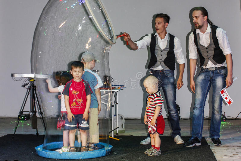 Play with soap bubbles at a children's event in Belarus. stock images