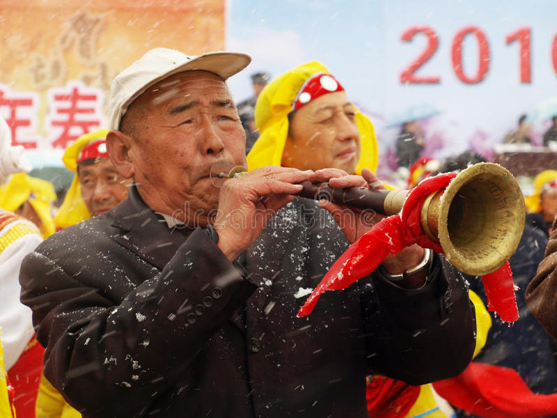 Play suona horn in the snow during Chinese New Yea stock photo