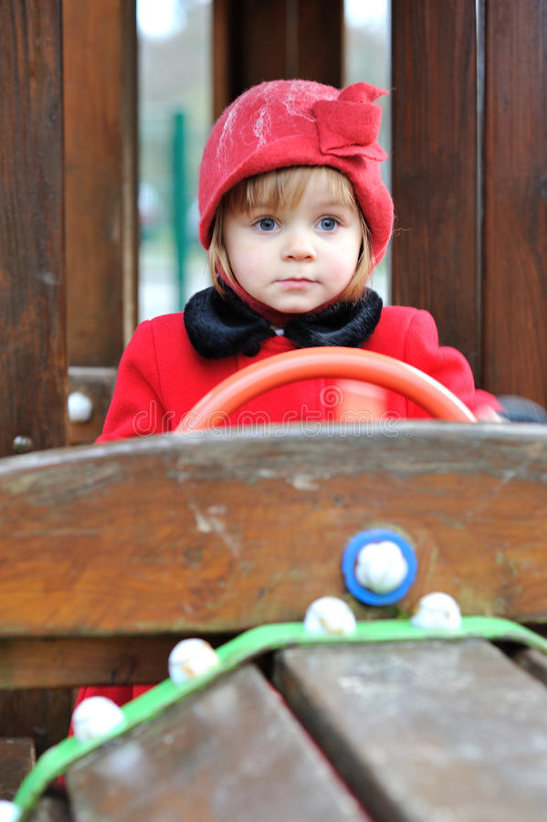 Play Time. A little girl sitting behind the steering wheel of a toy train stock images