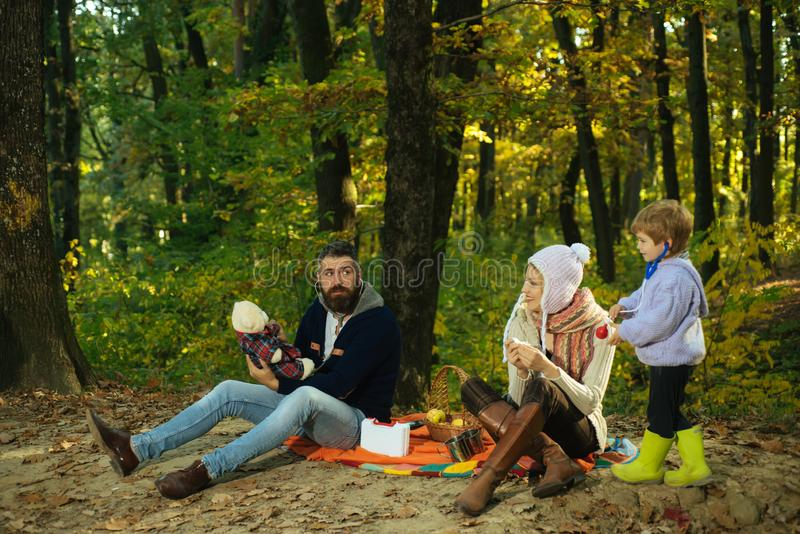Play together. Mother father and small son play in park. Happy family with kid boy relaxing while hiking in forest stock images
