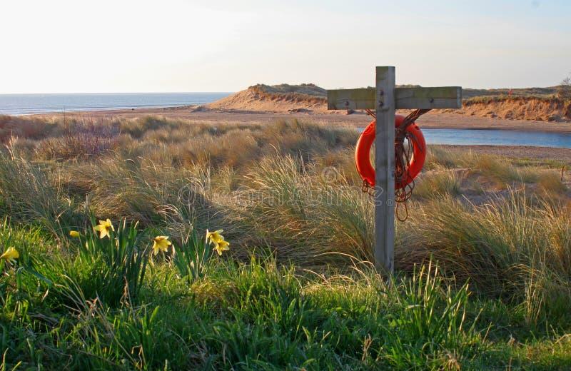Playa de la madrugada, de Alnmouth y bahía foto de archivo libre de regalías