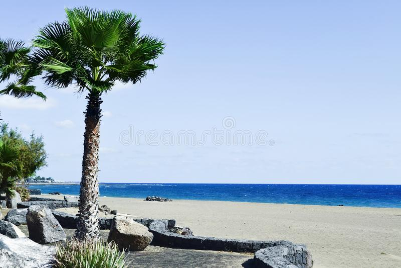 Playa de Matagorda beach in Lanzarote, Spain. A view of the Playa de Matagorda beach in Puerto del Carmen, Lanzarote, in the Canary Islands, Spain, with some stock photo