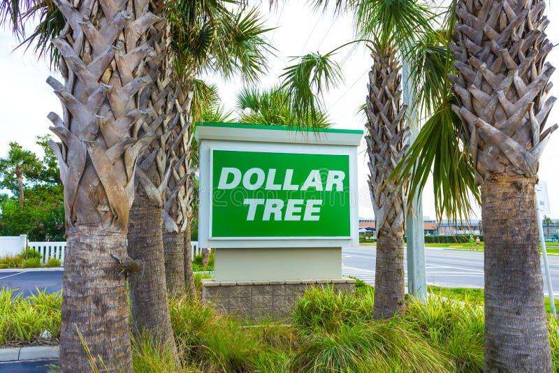 Playa del cacao, los E.E.U.U. - 29 de abril de 2018: Muestra del wellcome del árbol del dólar o logotipo de la tienda o de la tie imagen de archivo
