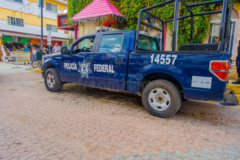 Playa del Carmen, Mexico - January 10, 2018: View of a blue police van parked at outdoors in 5th Avenue, the main street. Of the city. The city boasts a wide stock image