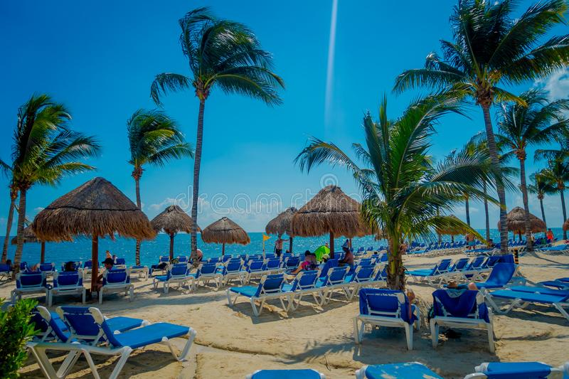 PLAYA DEL CARMEN, MEXICO - NOVEMBER 09, 2017: Unidentified tourists on the beach of Playacar at Caribbean Sea in Mexico royalty free stock photo