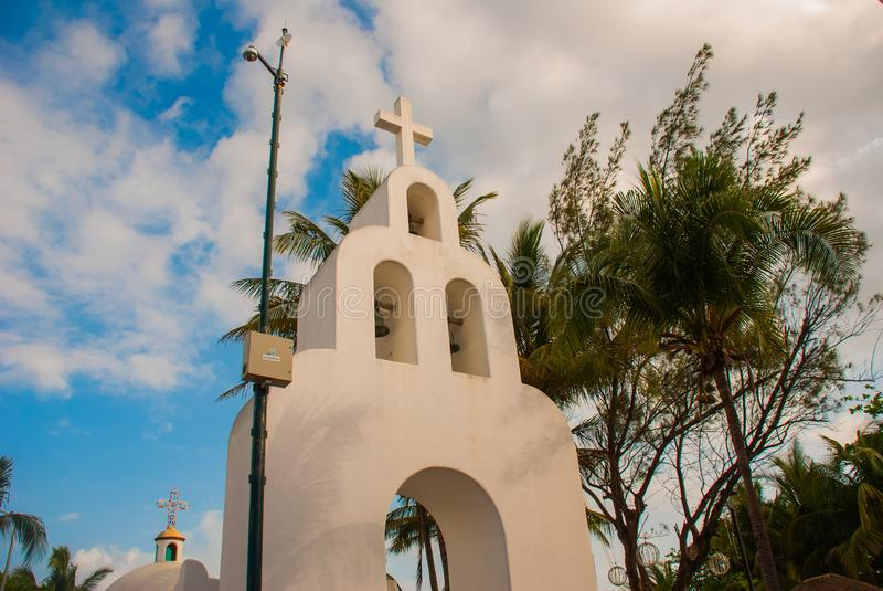Playa del Carmen, Mexico, Riviera Maya: The Catholic Church on the background of palm trees. Plaza Mayor.  stock photos