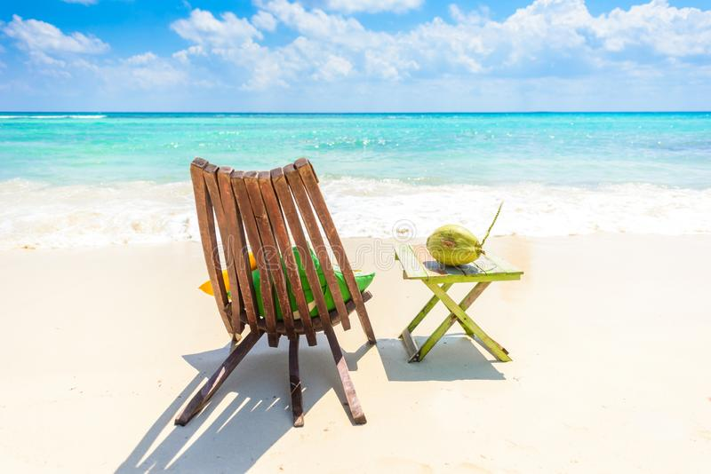 Playa del Carmen - relaxing on chair at paradise beach and city at caribbean coast of Quintana Roo, Mexico stock photography