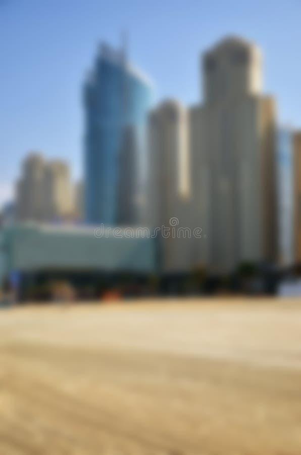 Playa del día y fondo borrosos de la ciudad imagen de archivo libre de regalías