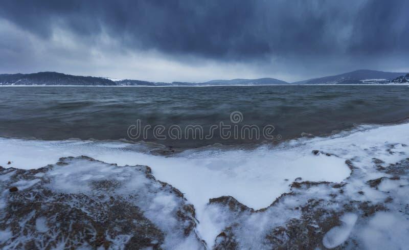 Playa fría, tormenta de la nieve imagen de archivo libre de regalías