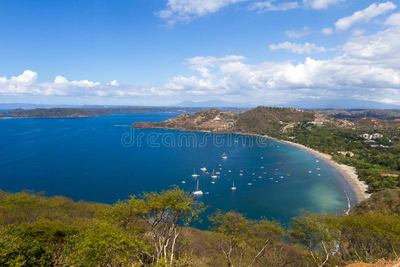 Playa Hermosa - Guanacaste, Costa Rica. Beautiful view of Hermosa Bay in Guanacaste Costa Rica, with deep blue water and white sand stock photography