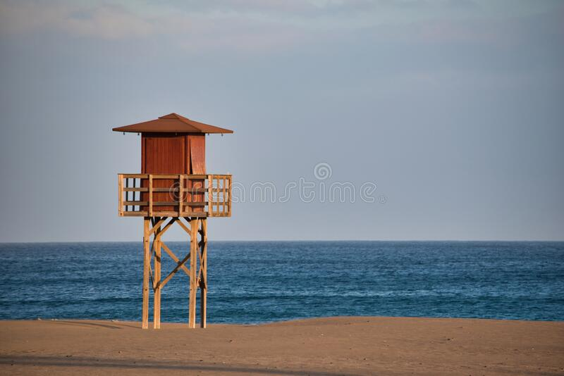 Playa Honda on the east coast of Lanzarote, one of the Canary Islands. Playa Honda, Lanzarote, Spain - April, 18 2020 : A lifeguard tower on the beach called stock image
