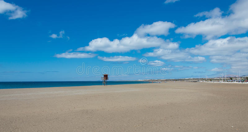 Playa Honda. Is one of the best beach in Lanzarote. It`s run along the international airport and near Arrecife. Here the beach with a lifeguard tower. Lanzarote royalty free stock image