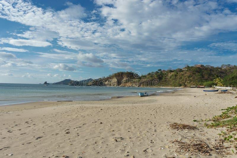 Playa Marsella, San Juan del Sur, NicaraguaRocky beach of Nicaragua with few waves, beautiful sunrise royalty free stock image