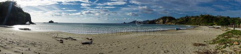 Playa Marsella, San Juan del Sur, NicaraguaRocky beach of Nicaragua with few waves, beautiful sunrise stock images