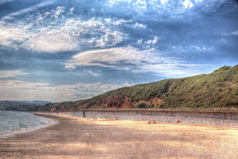 Playa roja Dawlish Warren Devon England de la roca en un día de verano en HDR imagen de archivo