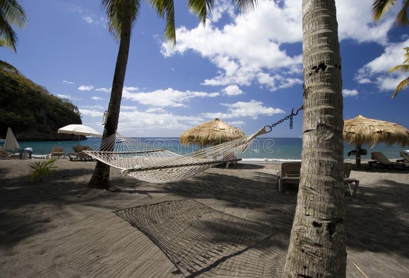 Playa y hamaca, St Lucia fotografía de archivo libre de regalías