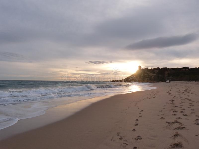 Playa y puesta del sol en España fotografía de archivo libre de regalías