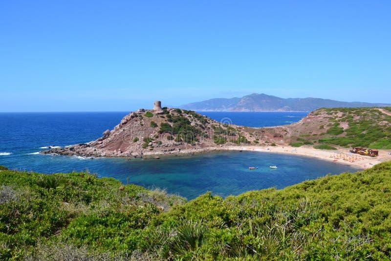 Playa y torre, Cerdeña - Italia foto de archivo libre de regalías