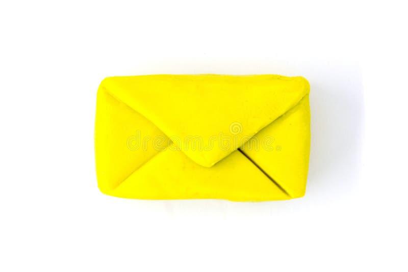 Playdough-Umschlag auf weißem Hintergrund stockfotografie