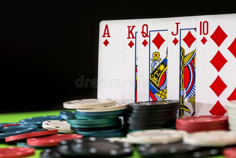 Played poker Chips and cards. In the background royalty free stock photography