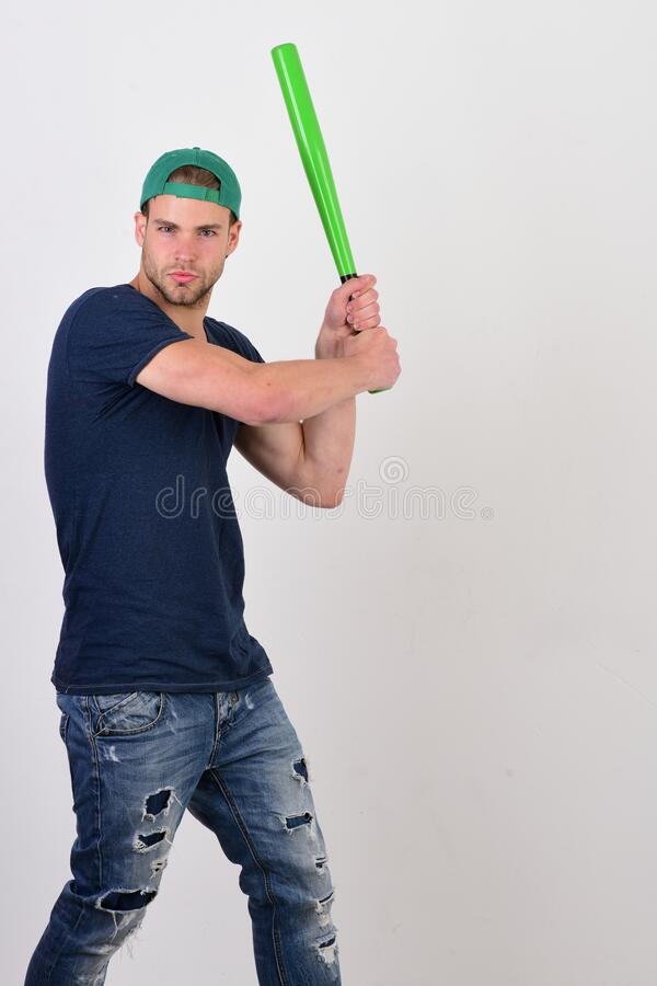 Player with concentrated face plays baseball. Sports and baseball training. Concept. Man with bristle on white background, copy space. Guy in dark blue tshirt stock images