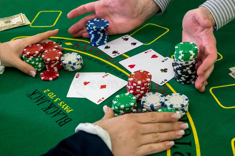 Player and dealer, raking pile of chips. royalty free stock image