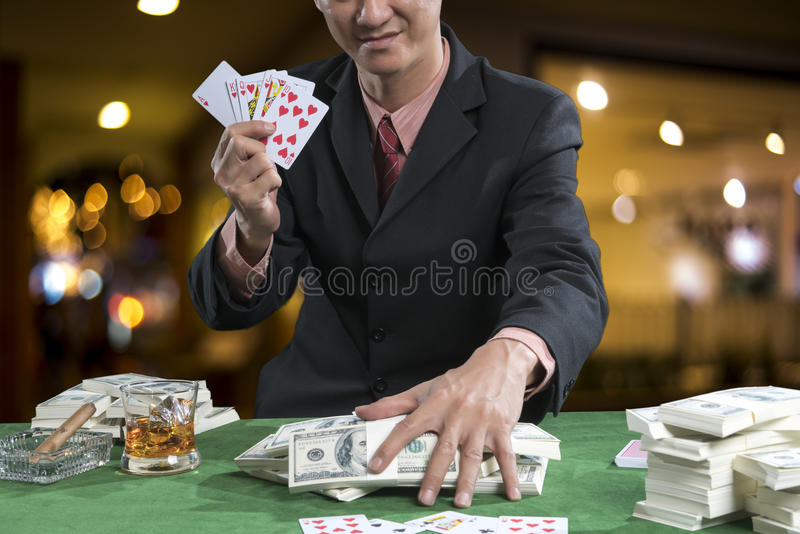 The player gather the bets when the points over rival on green t stock images