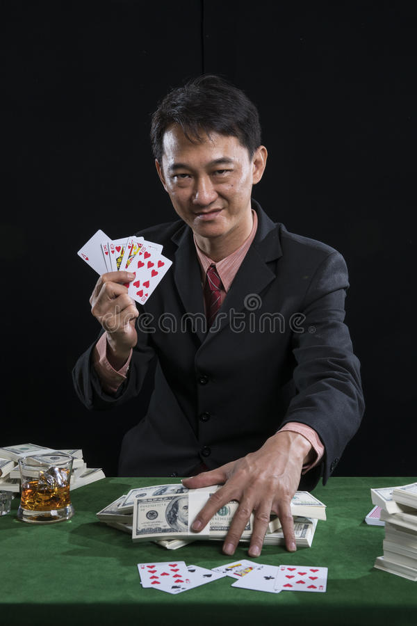 The player gather the bets and show the points over rival on green table royalty free stock photo