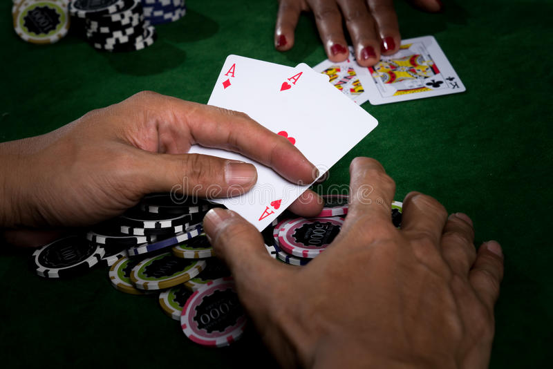 The player gather the chips stack when the points over rival stock photos